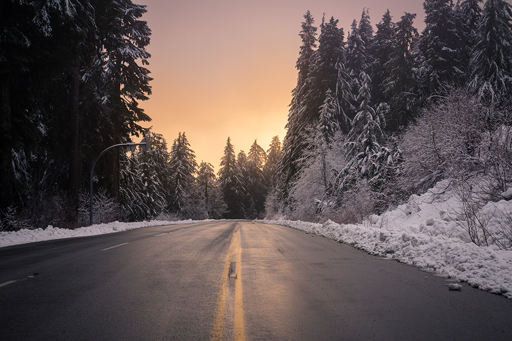 Snow sunset driving down the Mount Seymour Parkway